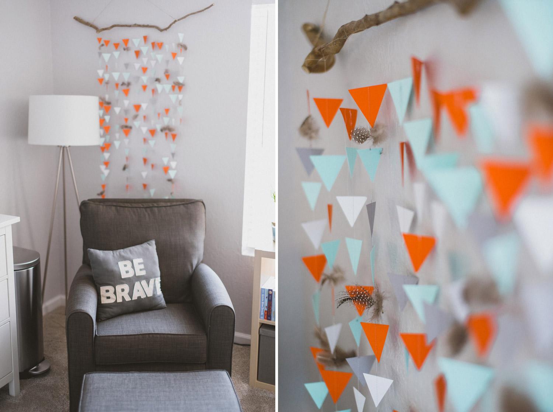 Paper orange and teal garland in baby nursery